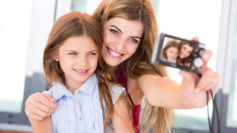 mother and daughter trying to take the perfect selfie